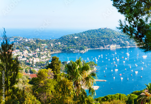 Aluminium Charming Blue Bay with a lot of yachts and boats anchored on the Cote d'Azur in Villefranche-sur-Mer, France.