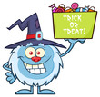 Cute Little Yeti Cartoon Mascot Character With Witch Hat Holding Up A Trick Or Treat Halloween Candy Basket. Illustration Isolated On White Background
