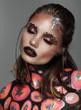 Fashion model with art make up orange and black color
