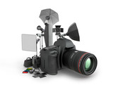 Photo studio concept. Camera and photo equipment on a white back