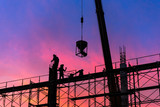 Silhouette of construction worker on scaffolding in the construction site. - 120855551