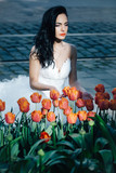 pretty wedding woman near red tulips