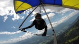Man maneuvers on a hang glider