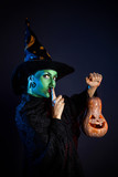 Wicked witch with pumpkin Lantern