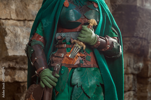 Poster Close up of elf's leather armor, sword and dagger