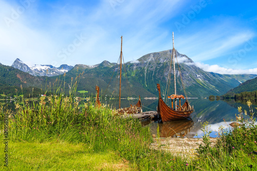 Old viking boat replica in a norwegian landscape Poster