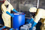 Workers in protective suits with toxic waste - 120965303