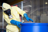 Workers in protective suits with toxic waste - 120965319
