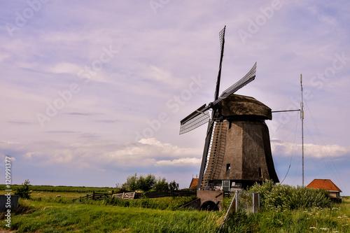 Fotobehang Purper Classic Vintage Windmill in Holland