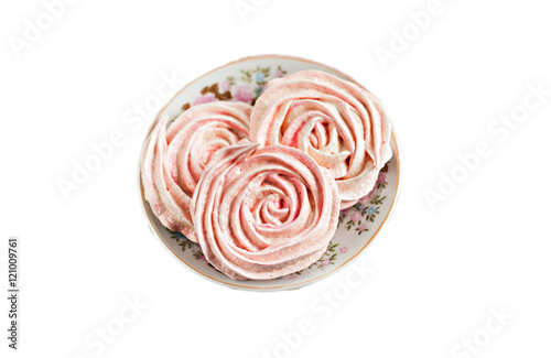 Poster Meringue cakes in the form of roses isolated