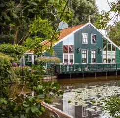 ZAANDAM, NETHERLANDS - AUGUST 14, 2016: Traditional residential Dutch buildings close-up. General landscape view of city building and traditional Dutch architecture. Zaandam - Netherlands.