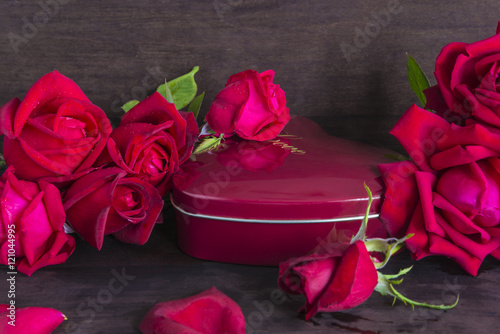 Poster Valentine composition with red roses and red gift box in form of heart isolated