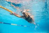 Woman swims underwater - 121098708