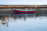 A rowboat moored in the dockside