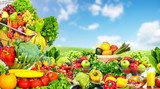 Vegetables and fruits over blue sky background.