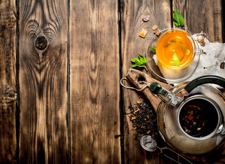 Kettle with fragrant floral tea.