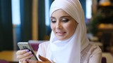 Young Muslim Girl Using Smartphone