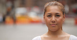 Young Latina woman in city face portrait - 121149311