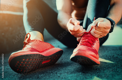 Tying sports shoes © ivanko80