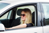 young blonde woman driver in her  car