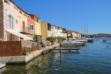 Pretty pastel colored houses on the waterfront in Port Grimaud in France