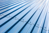 blue corrugated metal roof with rivets, industrial background  - 121200591