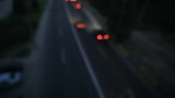 Abstract blurred background of night city road from above view