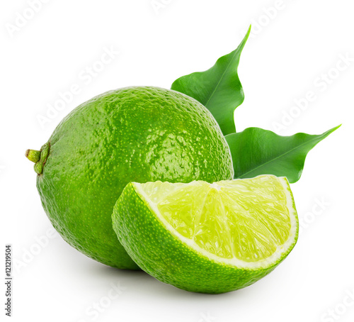 Whole and slice of lime with leaves