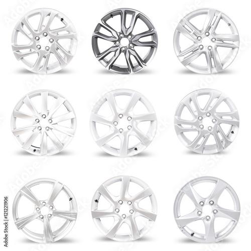Set of 9 isolated car wheels on white background