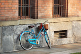 Bright blue bicycle on old street, Italy.