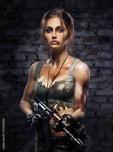 Beautiful girl with a gun in his hand Plakat