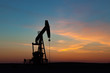 Oil Well Silhouetted Against Prairie Sunset
