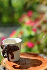 Morning coffee in garden.