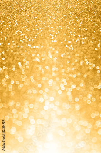 Glitzy gold glitter bokeh bling background or invite