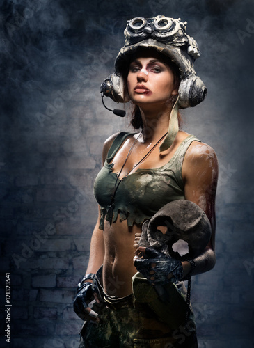 Portrait of sexy girls - a soldier with a skull trophy in hands