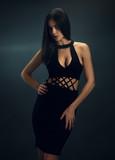 Sexy girl in black skin-tight dress