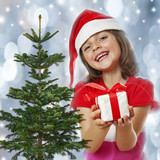 little girl with christmas gift and snowy background