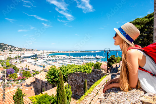 Plagát Young female traveler enjoying great view on french riviera in Cannes city