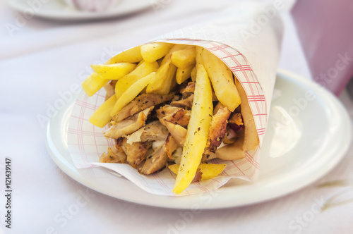 Greek gyro with fries close up on table