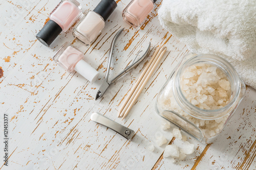Foto op Plexiglas Manicure Selection of manicure tools on white wood background