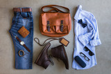 Flat lay of mens casual outfits with accessories on gray background