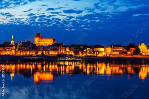 Fototapeta Torun, Poland: old town, cathedral, defensive wall, Vistula river