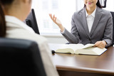 executive asian businesswoman talking in the office - 121512338