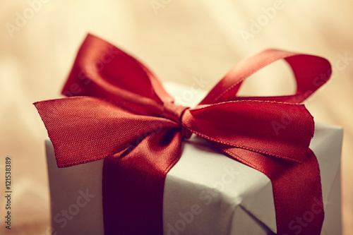 Poster gift box on the wooden background