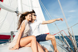 Young beautiful married couple embracing on the yacht - 121563153