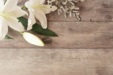 Floral frame with white calla, lilies on wooden background. Styled marketing photography. Copy space. Wedding, gift card, valentine