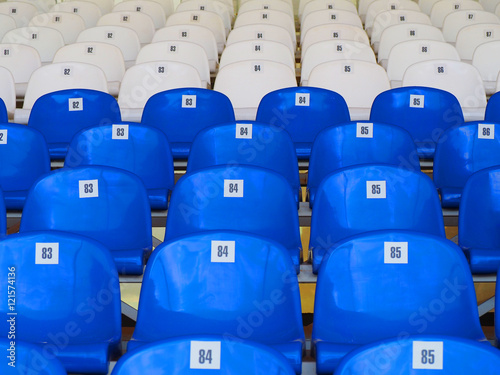 Poster Blue and white plastic armchairs on stadium