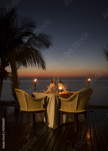 Staande foto Zanzibar Romantic dinner on a idyllic island facing the Ocean.