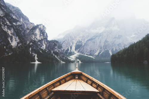 Wood boat in Braies lake - 121590187