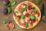 Pizza with figs, prosciutto and mozzarella.